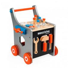 Каталка-игрушка Janod Тележка Brico'Kids 25 аксессуаров