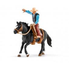 Schleich Фигурка Ковбой в седле на необъезженной лошади